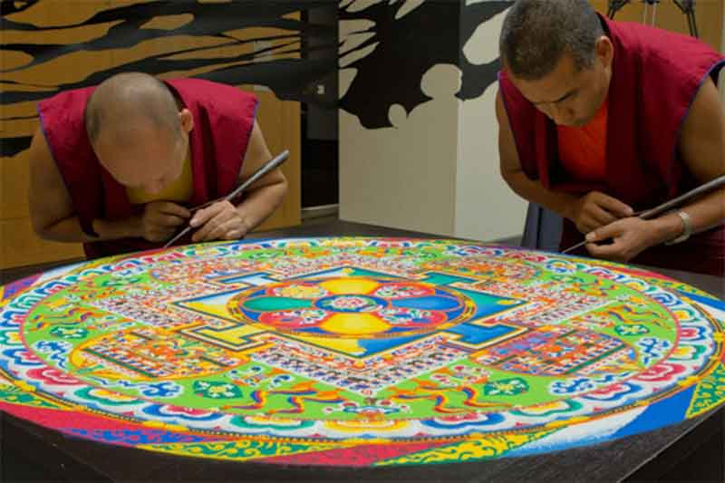 Monks are making Sand Mandalas