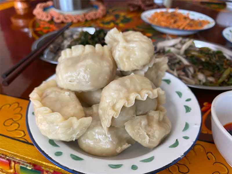 Eating momos in Lhasa in Tibet.