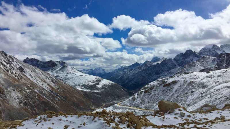 Tibetan owned travel agency: Driving the Tro La Pass with a Tibetan guide and driver