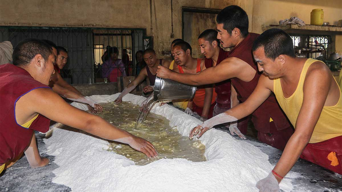 Drepung Loseling monks prepping the dough for Tibetan flatbread.