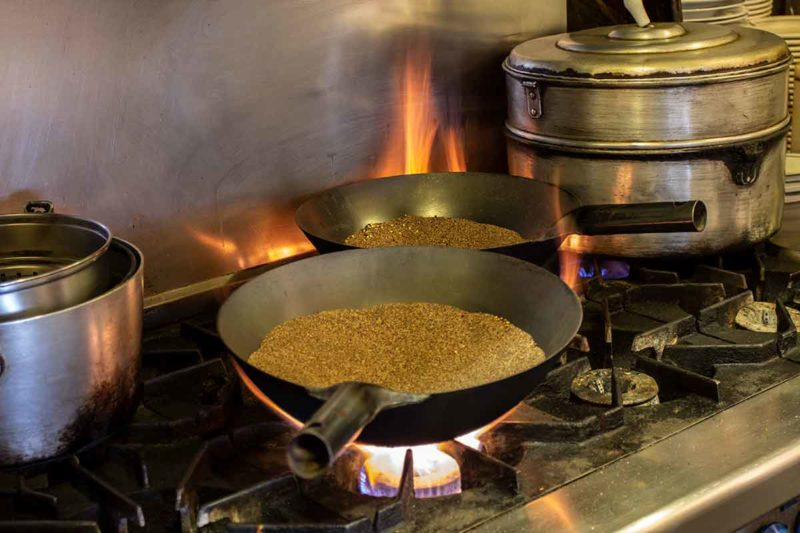 Tsampa: Heating sand to roast tsampa.
