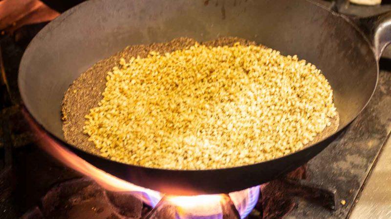 Roasting barley to make tsampa.