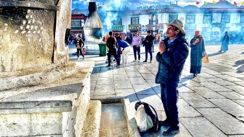Barkhor in front of Jokhang Temple in Lhasa, Tibet: Man praying
