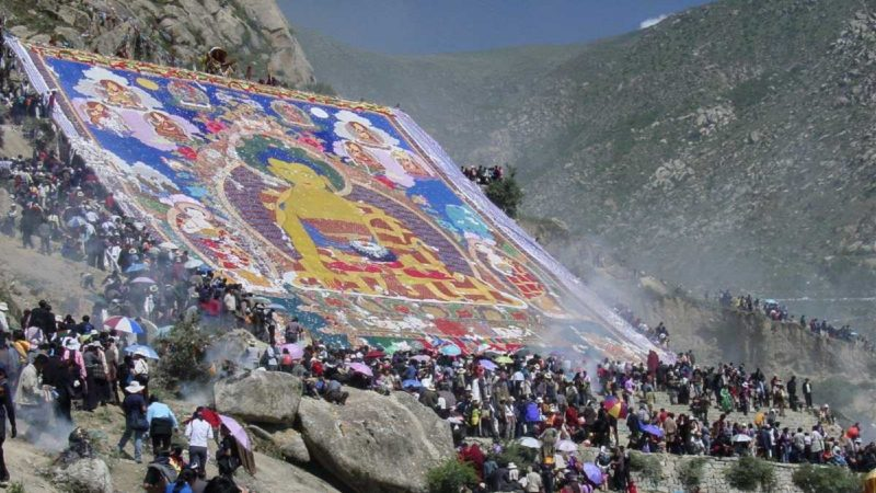 Giant thangkha of the Buddha Shakyamuni at the Shoton Festival, Drepung Monastery in Lhasa, Tibet.