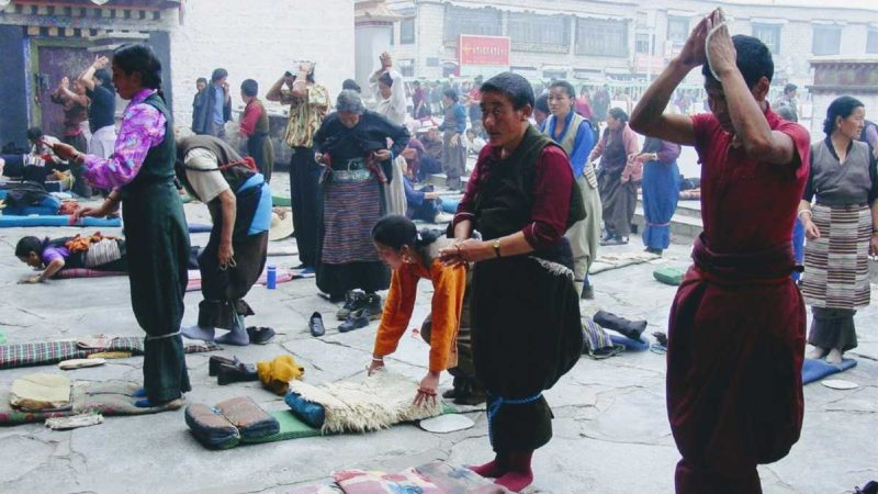 Tibetans prostrating in front of Jokhang Temple in Lhasa