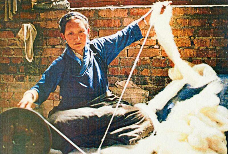Tibetan woman spinning wool at the Tibetan Refugee Center in Kathmandu, Nepal.