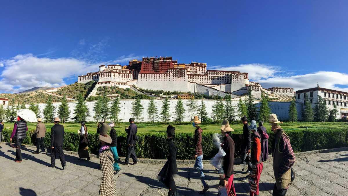 Tibetans circumambulating the Tsekor at the Potala Palace in Lhasa