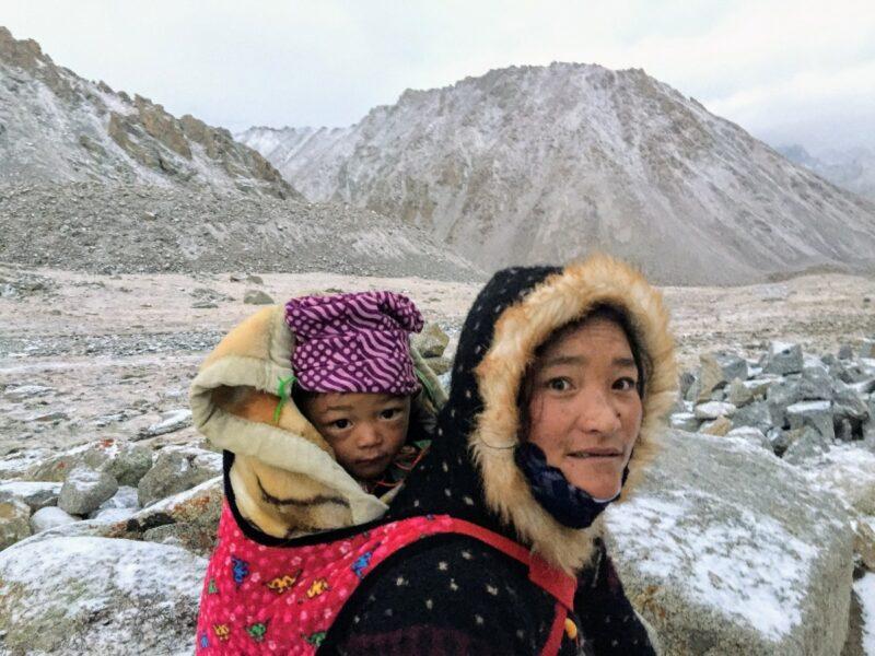 Tibetan pilgrim mother and child on  Dolma La pass